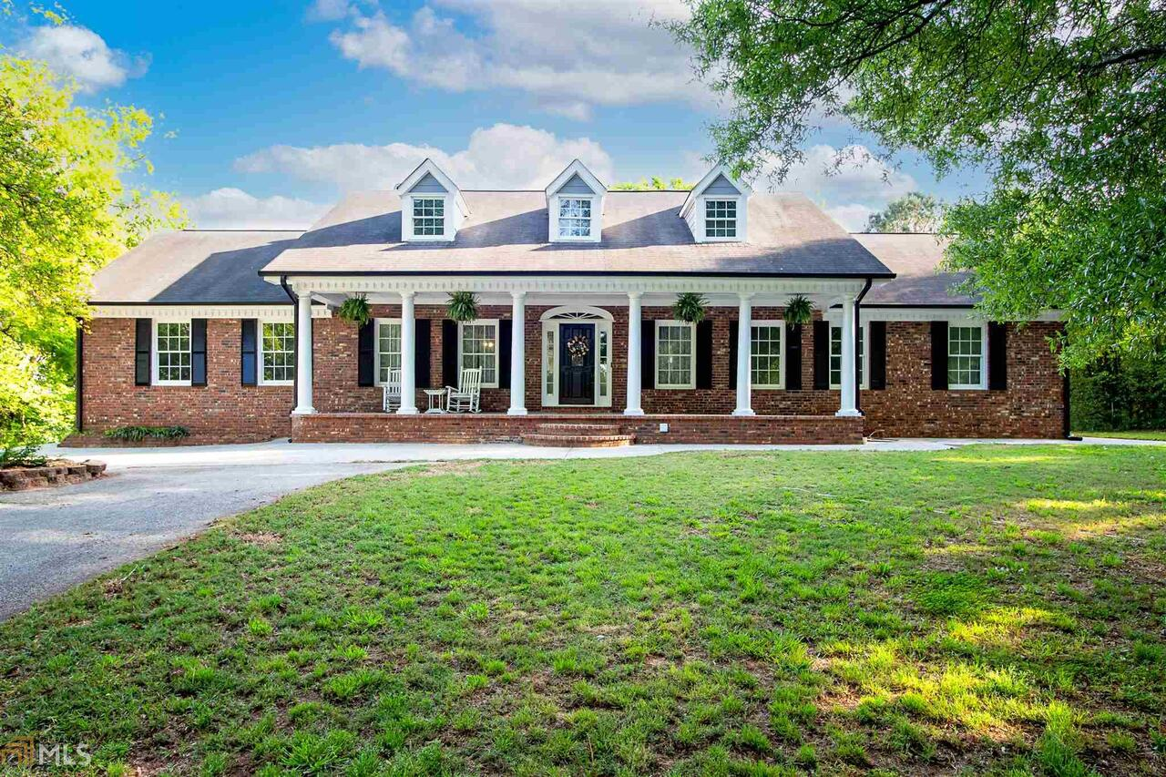 Beautiful estate in Southern Walton County! This 16.5 acre property features all the space and privacy you have been looking for. Long driveway leading up to the beautiful brick home. Main level features an open concept floorpan with living room, dining room and living room. Kitchen has been updated with granite countertops, stainless steel appliances and tile backsplash. Spacious master with exterior access, trey ceilings and ensuite bathroom. Two additional bedrooms and a large bathroom are on the main level. Upstairs there is a bedroom and bonus room. The basement makes the perfect inlaw suite or teen space! Full kitchen, living room with wood burning stove, 2 bedrooms and a full bathroom. The home has been updated with new flooring, paint, and the exterior has received a refresh as well! Located in the desirable Social Circle School district. Great location with easy access to Atlanta. Come see this beautiful property today!