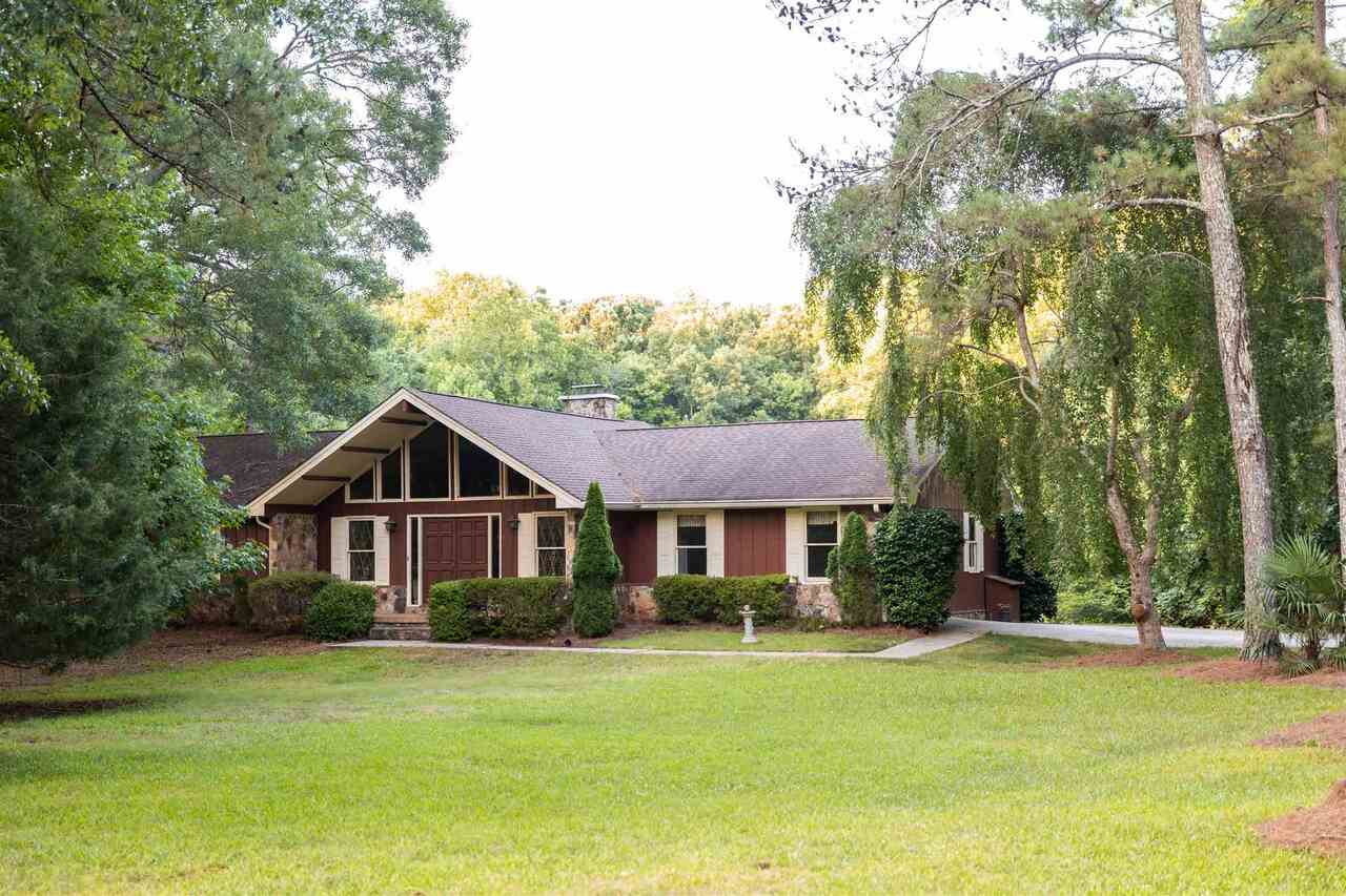 Southern living at it's finest! This property is so unique and rare. Over 16 acres with a private pond! The home is full of original details that you won't find just anywhere. On the main level you will find a large living room with vaulted ceilings and fireplace. Open kitchen and breakfast nook. Office right off of the garage. Master bedroom and two additional bedroom on the left side of the home. Large screened in porch overlooks the stocked pond. Basement with full bathroom offers tons of possibilities. Workshop with extra storage as well. You will love watching the deer and other wildlife in front pasture. Minutes to desirable Downtown Social Circle. Located in zone 5, buyer can select Social Circle or Walnut Grove schools. Call today for showings and more information.
