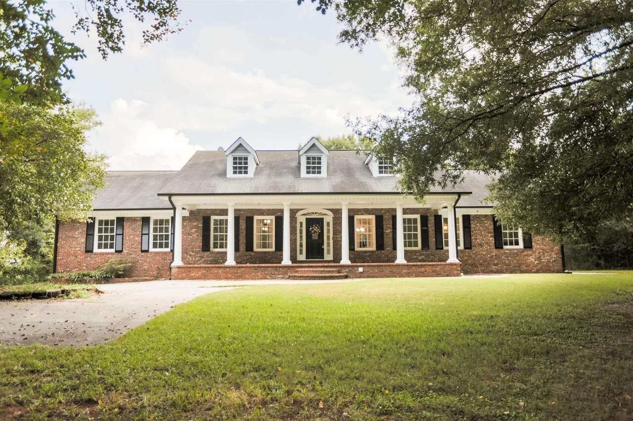 Beautiful estate in Southern Walton County! This 14.5 acre property features all the space and privacy you have been looking for. Long driveway leading up to the beautiful brick home. Main level features an open concept floorpan with living room, dining room and living room. Kitchen has been updated with granite countertops, stainless steel appliances and tile backsplash. Spacious master with exterior access, trey ceilings and ensuite bathroom. Two additional bedrooms and a large bathroom are on the main level. Upstairs there is a bedroom and bonus room. The basement makes the perfect inlaw suite or teen space! Full kitchen, living room with wood burning stove, 2 bedrooms and a full bathroom. The home has been updated with new flooring, paint, and the exterior has received a refresh as well! Located in the desirable Social Circle School district. Great location with easy access to Atlanta. Come see this beautiful property today!